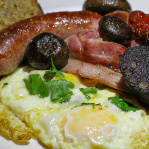Full English breakfast - fried eggs, pork sausage, blood sausage, bacon, tomato & mushrooms / The Breslin Bar & Dining Room (New York, 2014)